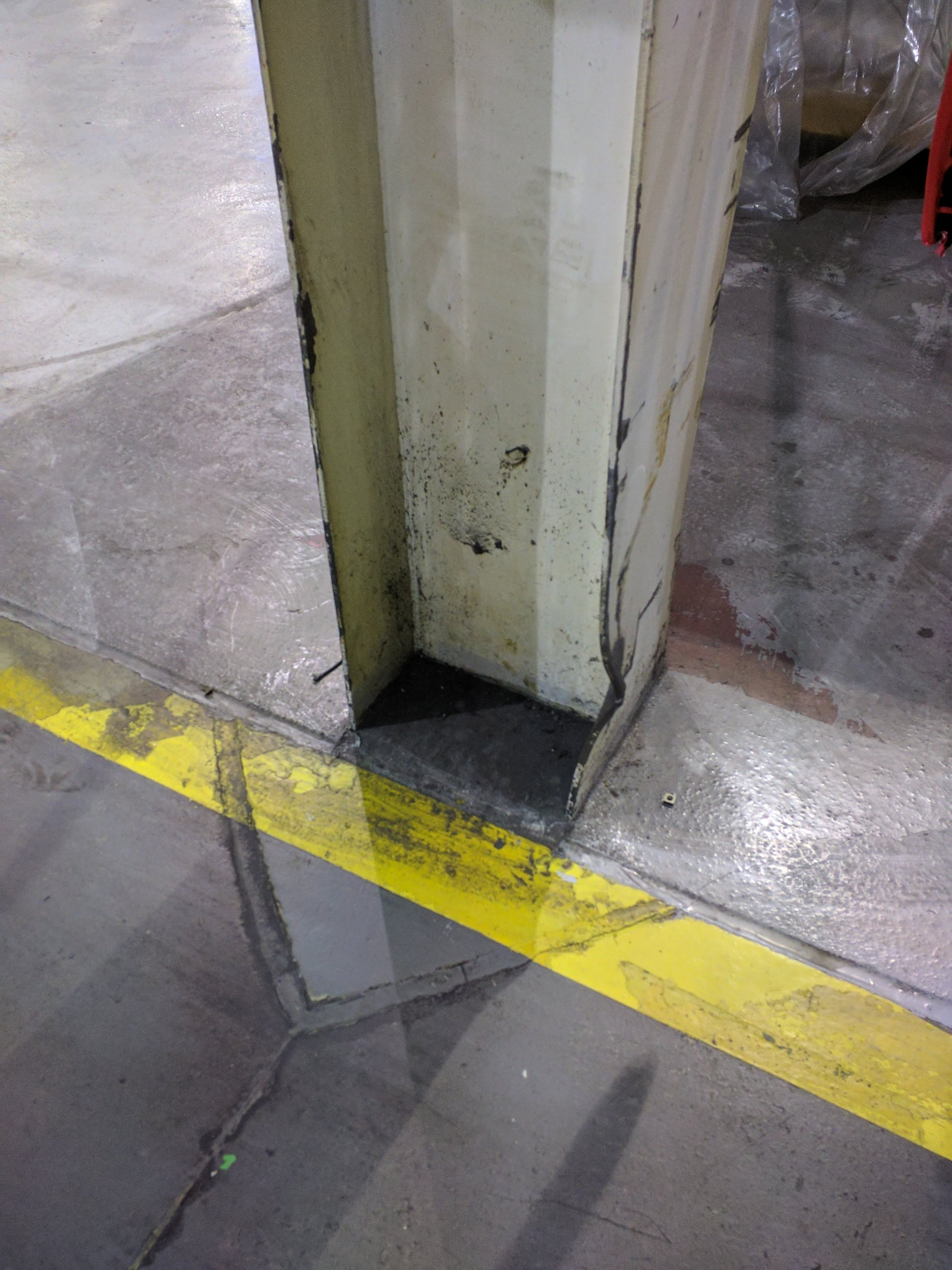 Damage to column adjacent to forklift aisle